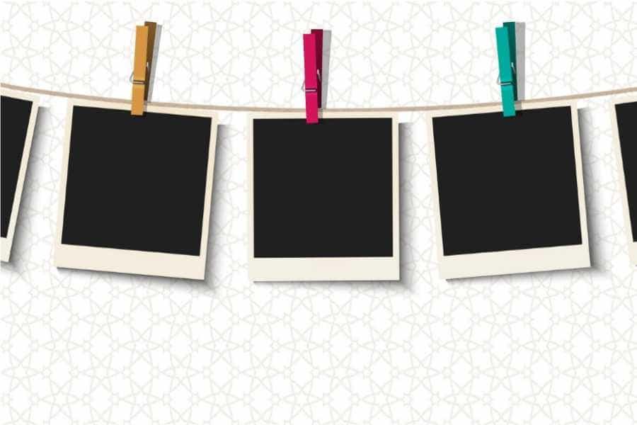 Fotografias colgadas con pinzas en una cuerda